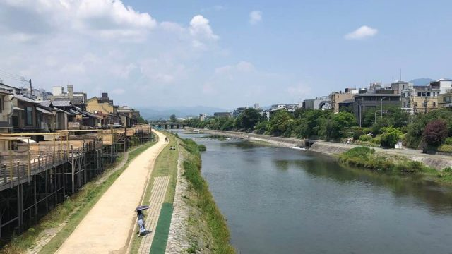 A view from Shijo Ohashi Bridge in Kyoto during summer noon
